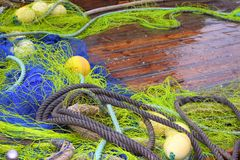 Fishemen professional tackle net boat wood deck Royalty Free Stock Images