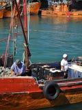 Fisher人工作在马德普拉塔por  免版税图库摄影