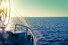 Fisher小船在海 作为设备捕鱼伙计智慧 免版税图库摄影