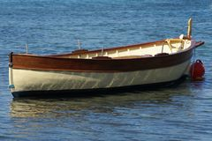 Fisher Boat. A traditional boat anchored in Mediterranean sea (French Riviera Royalty Free Stock Image