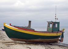 Fisher boat. Green fisher boat on the seashore Royalty Free Stock Photos