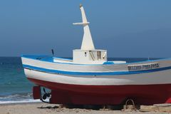 Fisher boat at the beach royalty free stock images