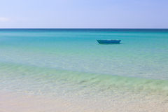 Fisher boat and clear turquoise water Royalty Free Stock Photo