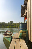 Fisher boat near by wooden house on Ko Rong Island, Cambodia Royalty Free Stock Photo