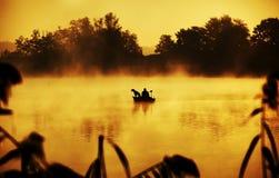 Fisher in boat Stock Photo