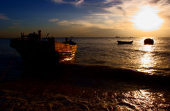 Fisher boat at sunset Royalty Free Stock Photo