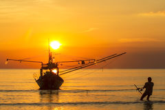 Fisher boat on sunset. A man and Fisher boat on sunset stock photos