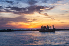 Fisher boat at sunset. In Thailand Stock Images