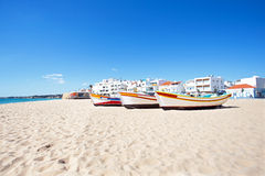 Fisher boats  at the beach in Armacao de Pera in Portugal Stock Image