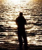 Fisher Boy. Scene of a boy silhouette fishing in the lake at sunset. Just beautiful Royalty Free Stock Images