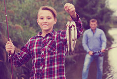 Fisher boy showing catch fish Royalty Free Stock Images