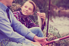 Fisher boy showing catch fish Royalty Free Stock Photography