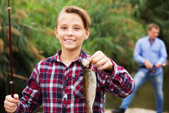 Fisher boy showing catch fish Stock Images