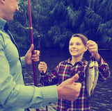 Fisher boy showing catch fish Royalty Free Stock Image