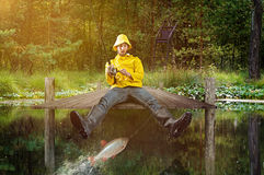 Fisher catches a Fish. Fisher catches a little Fish royalty free stock photos