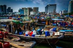 Fisher. City small fishing boat docks parked near the fishermen Stock Photography