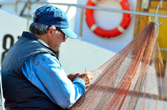 Fisher clinches the fishing net Stock Photos