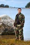 Fisher en orilla del lago Foto de archivo libre de regalías