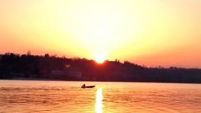 Fisher en puesta del sol Fotografía de archivo libre de regalías