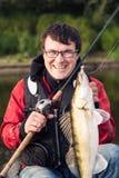 Fisher feliz imagens de stock