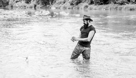 Fisher with fishing equipment. Fisher weekend activity. Fish on hook. Leisure in wild nature. Fishing masculine hobby