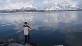 Fisher on fjord Stock Photography