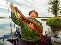 Fisher fortune, angler and fish Royalty Free Stock Photo