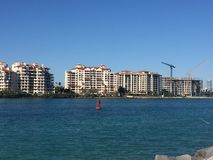 Awesome refuge for beautiful people. Fisher island, the jewel of Miami Beach ! On a special day where sky and sea are peaceful and amicable royalty free stock photo