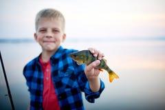 Fisher joven orgulloso con la captura Imagen de archivo libre de regalías