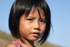Fisher kid with brown skin and reflect eyes at Binh Ba island, Khanh Hoa province, Vietnam Royalty Free Stock Photos