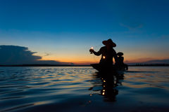 Fisher Lamplighter. Went home at sunset Royalty Free Stock Photo