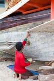 Fisher mężczyzna dylemat jego łódź obrazy stock