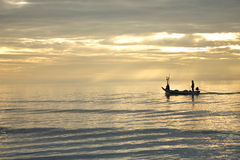 Fisher man and boat in the sea Hua Hin Thailand Royalty Free Stock Photos