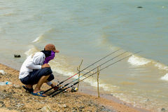 Fisher man with fishing rod Stock Image