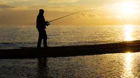 Fisher man with fishing rod silhouette Stock Photos