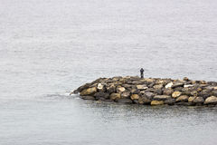 Fisher man with fishing rod Royalty Free Stock Image
