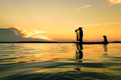 Fisher man. Fisher are sown dry river at sunset Royalty Free Stock Images