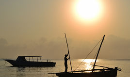 Fisher man at sunrise Stock Photos