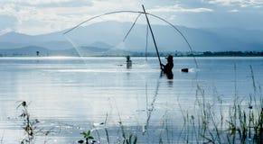 Fisher man use square dip net fishing at lake Royalty Free Stock Photos