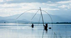 Fisher man use square dip net fishing at lake Royalty Free Stock Images