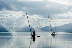 Fisher man use square dip net fishing at lake Royalty Free Stock Image