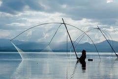Fisher man use square dip net fishing at lake Stock Image