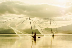 Fisher man use square dip net fishing at lake Stock Images