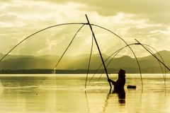 Fisher man use square dip net fishing at lake Royalty Free Stock Photography