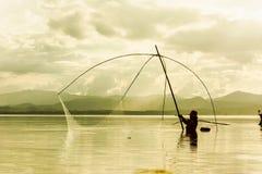 Fisher man use square dip net fishing at lake Stock Photography