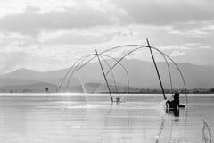 Fisher man use square dip net fishing at lake Royalty Free Stock Photo