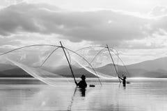 Fisher man use square dip net fishing at lake Stock Photos