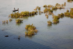 Fisher man working in their boat on the Niger River Royalty Free Stock Photos