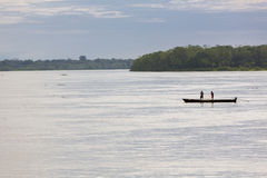 Fisher men in action on the Amazon River, Brazil Royalty Free Stock Photography