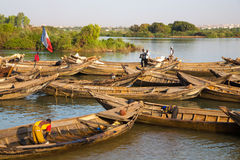 Fisher men working in their boat on the Niger River Royalty Free Stock Photo